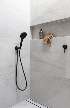Using large tiles in your bathroom shower is easy, and you can avoid numerous tile cuts. Large Tile Bathroom, Laundry In Bathroom, Concrete Bathroom, Bathroom Vanities, Bathroom Faucets, Bathroom Design Luxury, Bathroom Design Small, Bathroom Tile Designs, Shower Designs