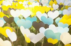 Heart picks decorated the front lawn and were  repeated in the wedding decor   Modern Handmade Desert Wedding: Trisha + Justin