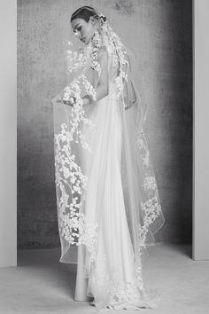 Elie Saab Satin Sheath Dress with Long, Flower-Embellished Veil Spring 2018   http://www.brides.com/photos/elie-saab-satin-sheath-dress-with-long-flower-embellished-veil-spring-2018
