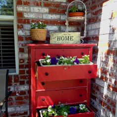 Red distressed dresser used on my front porch as a planter. It's still a work in progress...