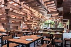 Stacks of timber create an open light-filled space for this restaurant