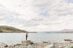 An epic Lake Tekapo wedding, surrounded by mountain views and lupins at the height of spring! Married in the Church of the Good Shepherd. So many colourful summer blooms created the backdrop for so many bridal portraits! Lake Tekapo, Anna, The Good Shepherd, Bridal Portraits, Mountain View, Auckland, Bride Groom, Summer Wedding, In The Heights