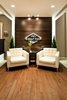 could push back entry wall for coat/entry storage on the R side with this as the logo wall & a lounge area--it's a smaller lounge area, but if they don't have clients often that may make sense--and these could be on wheels to pull over when they meet at their pinboard.