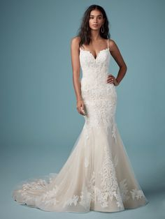 Delicate beaded lace motifs cascade throughout this romantic tulle fit-and-flare wedding dress. A sweetheart neckline, beaded spaghetti straps, and plunging illusion back complete the gown. Look amazing in Glorietta by Maggie Sottero. Western Wedding Dresses, Modest Wedding Dresses, Designer Wedding Dresses, Bridal Dresses, Wedding Gowns, Bridesmaid Dresses, Wedding Dresses Fit And Flare, Elegant Dresses, Sexy Dresses