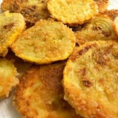 Deep Fried Squash  Vegetable oil, for frying 1/2 cup whole buttermilk 3 large eggs 4 medium yellow squash, cut into 1/4-inch thick slices 1 cup yellow cornmeal 1 cup all-purpose flour 3 tablespoons Cajun or Creole seasoning 1/2 teaspoon baking powder 1/4 teaspoon salt Freshly ground black pepper Chopped fresh parsley, for garnish