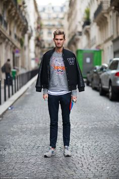 For an everyday outfit that is full of character and personality pair a black bomber jacket with navy chinos. For footwear go down the casual route with grey low top sneakers. Shop this look for $112: http://lookastic.com/men/looks/bomber-jacket-crew-neck-sweater-crew-neck-t-shirt-chinos-low-top-sneakers/5864 — Black Bomber Jacket — Grey Print Crew-neck Sweater — White and Navy Horizontal Striped Crew-neck T-shirt — Navy Chinos — Grey Low Top Sneakers