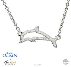A simple and elegant sterling silver dolphin pendant achieves awe-inspiring beauty, embellished with brilliant white Swarovski® crystals. This playful keepsake piece captures the unique, bright personality of the brilliant sea creature. Ocean Jewelry, Dolphin Jewelry, Crystal Guide, Sterling Silver Pendants, Custom Jewelry, Jewelry Collection, Antique Jewelry, Swarovski Crystals, Pendant Necklace