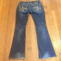 """ROCK REVIVAL Size 26 -Genuine @ A Replica Price! Size 26 rock revival jeans. GWEN BOOT style. 98% cotton 2% elastane.  The waistband when lying flat measuring side to side is 15"""". The rise measures 7 1/2 inches. Inseam measures 29 inches. Light distressing is factory made. Genuine article not a replica. No defects. The only damage can be seen in the first pic, at the bottom hem, the jeans had touched the ground & started to wear a bit. That is the only issue with the jeans. Gently worn…"""