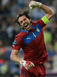 Italian goalkeeper Gianluigi Buffon celebrates his team's victory and the fact that Spain had beaten Croatia 1-0, meaning that Italy advances at the European Championship.