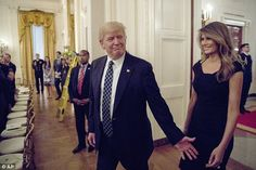 Melania Trump in black Roland Mouret dress at reception for senators and their spouses at the...