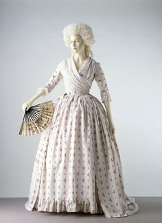 Robe à l'Anglaise, England, c. 1785.  Printed white cotton with a design of floral sprays in pink, blue and green alternating with smaller floral sprays, lined with linen.
