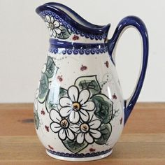 Wow! How beautiful hand painted and stamped pitcher is this one. Love Polish pottery! :)