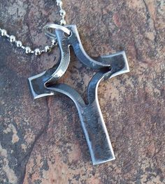 My hand forged cross necklace pendent is made from a piece of recycled 1/4 square stock, it is split in two different directions and heated cherry red in the forge and hammered out on the anvil to make the cross shape, once the desired shape is reached I lightly wire brush the cross and clear coat it with a high quality automotive clear to preserve the natural beauty of the steel.  Do to the nature of these being hand made one at a time the size, shape and color may vary a little from the…
