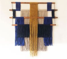 macrame wall hanging made with pieces of an old weaving loom and strips of leftover fabric | ANNIENKE (scheduled via http://www.tailwindapp.com?utm_source=pinterest&utm_medium=twpin)