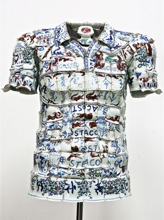 """Li Xiaofeng (1965), sculptor and fashion designer. Chinese artist Li Xiaofeng uses broken slivers of porcelain found at archaeological sites to create original costumes he calls """"rearranged landsca..."""