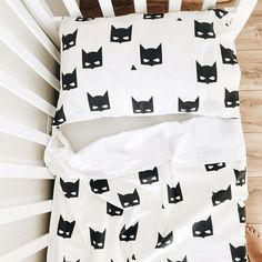 So simple and so stylish black and white baby bedding Batman.  This crib bedding set includes:  - 1 white fitted crib sheet. Fits mattress - 24 x 48 (60cm x 120cm) - 1 pillow case Batman 16 x 24 (40cm x 60cm) - 1 duvet cover Batman (one side is printed, the other is white) 40 x 52 (100cm x 130cm)  Fabric: 100% cotton  Packed in white Karamba boxes (pic)  Shipping Information:  If the item is in stock it takes 1-3 days to ship, if the item is out of stock it takes 1-2 weeks.  Not exactly…