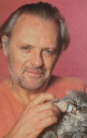 Anthony Hopkins.... bottle feeding a kitten....the kitten looks as perplexed as I am!