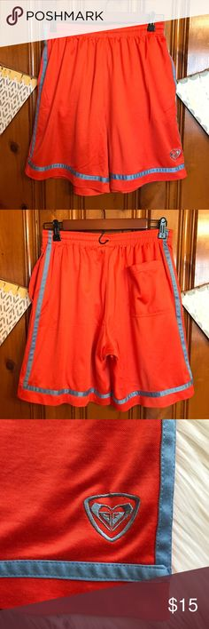 """Vintage 90's Roxy Comfy Shorts I purchased these in the late 90's. Super cute and comfy. Bright orange and turquoise. Side pockets and a back pocket. 8"""" inseam and 14"""" elastic waist laying flat. One sided drawstring on the inside (see pic). I think it's always been missing a side but I never used it anyway. 75% polyester 25% cotton. Very good used condition with lots of wear left. Shows normal wear from washing. Made in the USA! Roxy Shorts"""
