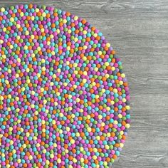 Our felt ball rugs are hand felted and sewn (not glued) in Kathmandu, Nepal using beautiful wool sourced from New Zealand and are free from chemicals, eco-friendly and most importantly, certified fair-trade.  All felt ball rugs come with a FREE 2 metre, matching felt ball garland