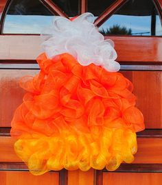 Candy corn wreath -- could probably make these out of yellow, orange, and white shower loofahs!