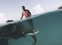 Nazroo, a Mahout, poses for a portrait while taking his elephant, Rajan, out for a swim in front of Radhanagar Beach in Havelock, Andaman Islands. Photograph by Cesare Naldi.