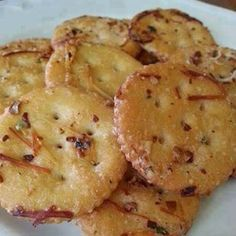 Fire Crackers: Crackers (Ritz, Oyster or Saltines); 1 stick melted butter (or olive oil); 1 pkg dry dressing mix (Ranch, Zesty Italian, etc); 1/4 c grated Parmesan cheese; 1 tbsp red pepper flakes (ground in processor); 1 tsp garlic powder. Toss crackers with all 5 ingredients. Bake @ 300° for 15 mins. Enjoy!