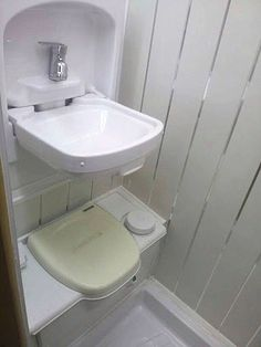 Toilet with fold up sink above for efficient use of space in in van interior converted by Céide Campervan Conversions, Co. Donegal,  Ireland