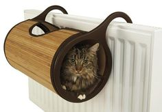 Cats (and gadget bloggers) love a nice warm cozy place to curl up. Your radiator is warm. Boom, why not hang a cat bed off the radiator? Boom, done. This Jolly Moggy Bamboo Cat Bed is a little roll up bed that hangs on your radiator.