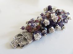 Check out this item in my Etsy shop https://www.etsy.com/uk/listing/291753659/purple-bag-charm-skull-bag-charm