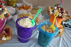 Food in sand pails for beach theme birthday-party-ideas