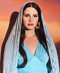 WHY DID LANA DEL REY MAKE A 30-MINUTE VIDEO ABOUT GOD, AND WHAT DOES IT MEAN FOR ME? Celebrity gods, strippers and guns, and the poems of Wa...