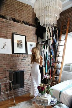 No storage? No problem. Use multi-tiered racks to cozy up a corner with your most pride-worthy outfits and accessories