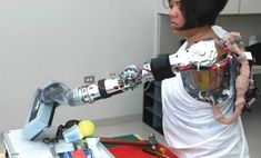 prostetic robotic limbs | patient tests a prototype prosthetic limb being developed by DARPA ...