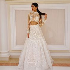 Manish Malhotra on Couture . the classic White and Skin/Beige and pearl drops while mod lehenga choli . Beautiful and a very Glamorous Indian Style Statement . Stunning on the very young and gorgeous Khushi Kapoor on via Indian Bridal Wear, Indian Wedding Outfits, Pakistani Outfits, Indian Wear, Indian Outfits, Indian Style, Indian Clothes, Wedding Dresses, Mode Bollywood