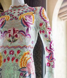 Psychedelic embroidery details on the Glint Midi Show Dress