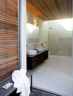 Cool Bungalow Made Of Wood And Glass : Modern Bungalow Design With White Bathroom Walls Wooden Beams Wash Basin Mirror Lamp Glass Shower Towel Ceramic Floor And Chair And Wooden Furniture Modern Wooden House, Modern Lake House, Wood Slat Wall, Wood Plank Walls, Wood House Design, Modern House Design, Bad Inspiration, Bathroom Inspiration, Bathroom Ideas