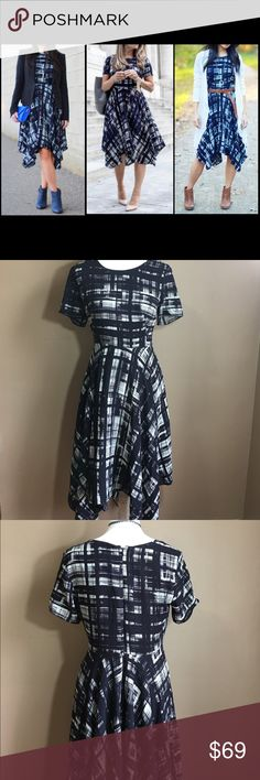 """Anthropologie Corey Lynn Calter Plaid Dress SOLD OUT!! Reaping experience from opera houses, broadway shows and New York punk rock scene, Corey Lynn Calter's eponymous collection is composed of original prints, uber-flattering cuts and punchy hues that were inspired by her vast and varied background.  By Corey Lynn Calter Back Zip 100% rayon Dry clean Navy blue & white  Measurements laying flat: 17.5"""" armpit to armpit  30"""" waist  40"""" length (longest) 30"""" length (shortest) Anthropologie…"""