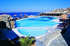 Mykonos Grand Hotel – Greece-Elegant and Greek beauty surrounds you once you step in Mykonos Grand Hotel. Besides luxurious suits with private pool, the gorgeous balcony and view are extremely stunning.