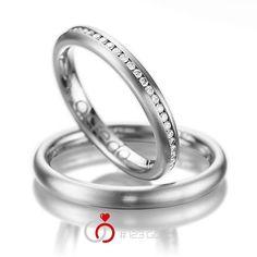 1 Paar Trauringe - Legierung: Weißgold 585/- Breite: 3,00 - Höhe: 2,20 - Steinbesatz: 48 Brillanten zus. 0,48 ct. tw, si (Ring 1 mit Steinbesatz, Ring 2 ohne Steinbesatz)
