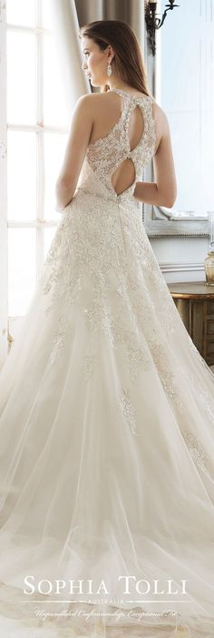 Wedding Dress by Sophia Tolli | Sleeveless tulle over satin A-line gown featuring crystal encrusted beading, lace appliqués adorn bodice and full skirt, natural waist, an illusion lace double keyhole back. #weddingdress #weddingdresses #bridalgown #bridal #bridalgowns #weddinggown #bridetobe #weddings #bride #weddinginspiration #weddingideas #bridalcollection #bridaldress #fashion #dress See more gorgeous bridal gowns by clicking on the photo