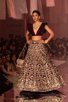 INDIAN FASHION Love the choli blouse and the colors: Manish Malhotra at Lakmé Fashion Week winter/festive Indian Wedding Lehenga Choli. Manish Malhotra Bridal Lehenga, Indian Bridal Lehenga, Indian Bridal Outfits, Indian Designer Outfits, Indian Dresses, Indian Designers, Indian Clothes, Bridal Dresses, Designer Dresses