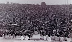 Historical Pics @HistoricalPics   Opening ceremony at Woodstock with Swami Satchidananda giving the opening speech, 1969. Photo by Mark Goff.