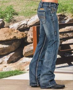 "Cowgirl Tuff ""Don't Fence Me In"" Stone Wash Mid-Rise Relaxed Fit Boot Cut Jeans - Get an unmistakable style by wearing these Don't Fence Me In dark stonewash blue jeans from Cowgirl Tuff.   These denims come with the signature barbwire stitching on the back pockets. For that broken-in look, the design adds fading and whiskering throughout the jean -  