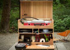 How to Build Your Own Camp Kitchen Chuck Box - REI Blog   add magnet to hold propane tank;  add LED lights  ... look in commetns for video with other ideas
