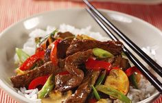 Sizzling Beef Stir-Fry - The first time Grandma served up these tender strips of steak, mushrooms and red pepper was the night I learned how to use chopsticks.