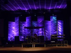 Edgy stage design constructed with steel panels wrapped with plastic wrap. Just one of many set design ideas @ www.leapofaith.com