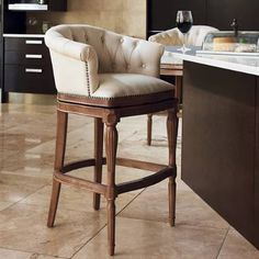 Almost as enveloping and comfortable as an overstuffed armchair, the embrace of our handcrafted Channing Swivel Barstool is one you won want to leave. The button-tufted arms and back flow together in a single graceful curve, cushioned with memory foam for the ultimate sit. The hardwood legs are turned and fluted and the corner blocked frame is built to last. Smoothly swivels 180.Upholstered with easy-care linenSeat cushioned with memory foamHandcrafted of solid hardwood, with artistically…