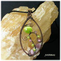 Copper wire wrapped pendant with cats eye in a satin by JOINHAS