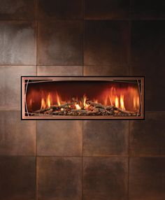 Completely transform your experience with countless fronts and media combinations- This pairs our Willowbrook front in Antique Copper with Twigs as a fire place.