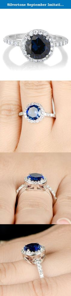 Silvertone September Imitation Birthstone Ring - Blue CZ. Celebrate life with a Silvertone Imitation Birthstone Ring! Imitation Birthstone rings are the perfect way to gift someone something special on their birthday. This September SimulatedSapphire CZ ring features a 2 carat round cut stone that is surrounded by petite size clear stones giving off the angelic halo effect. Smaller size CZs extend partially down each side of the band for even more radiance. Sparkle in style during your…